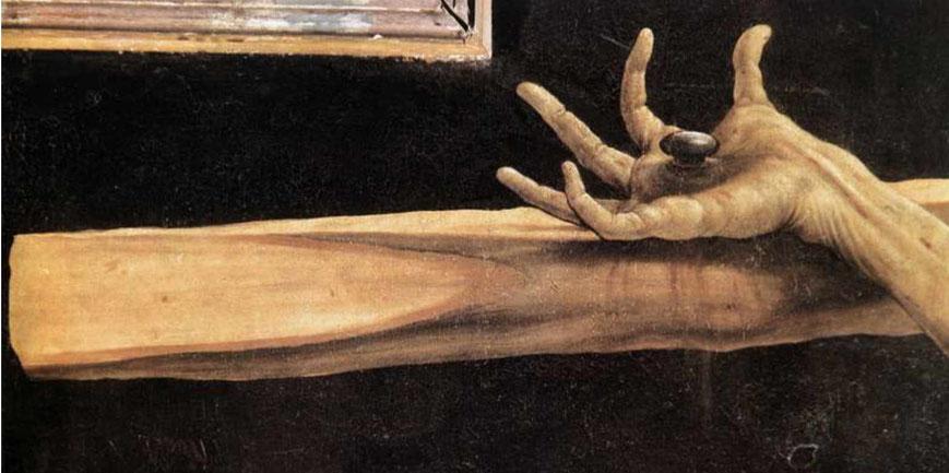 Isenheimer Altar. Detail der Kreuzigung Christi. Die verkrampfte Hand wird als Hinweis auf das Heilige Feuer gedeutet.