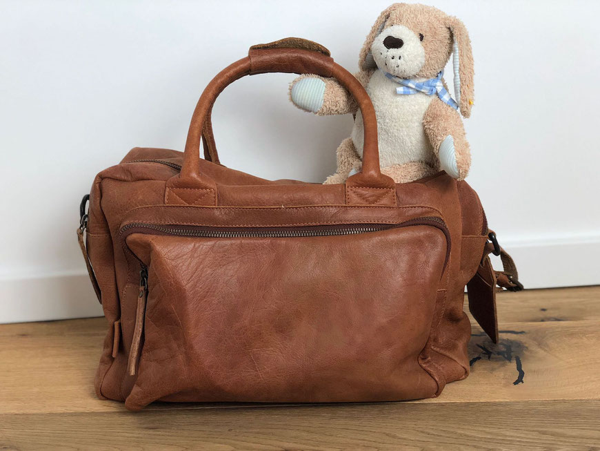 Reisen mit Baby - Reisetasche für Baby mit Kuscheltier