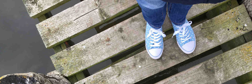 Canvas shoes on a boardwalk