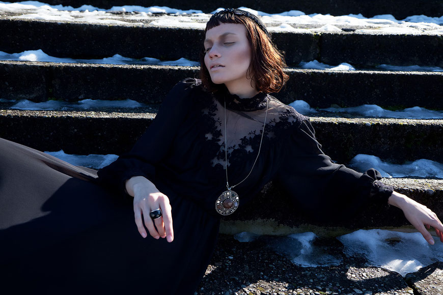 Fashion photography, a woman sit down on the snow by Monica Monimix Antonelli