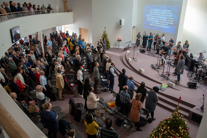 Church service with large congregation and band