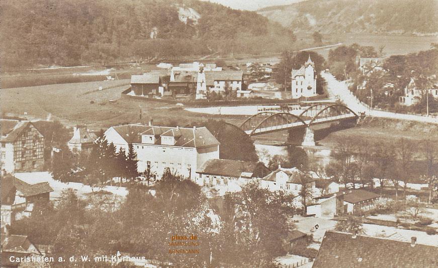 Die Weserbrücke von Carlshafen in den 1920er Jahren mit Häusern auf beiden Uferseiten