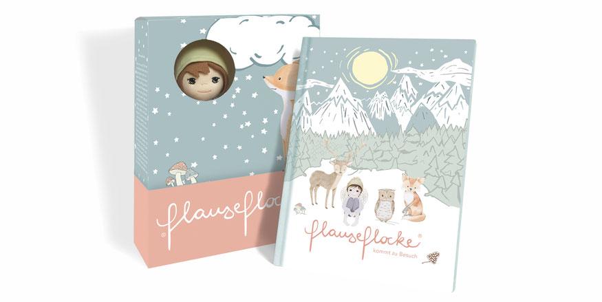 Kunstvoll illustrierte Verpackung für Kinder mit einem kleinen Schutzengelpuppe und einem Kinderbuch davor.