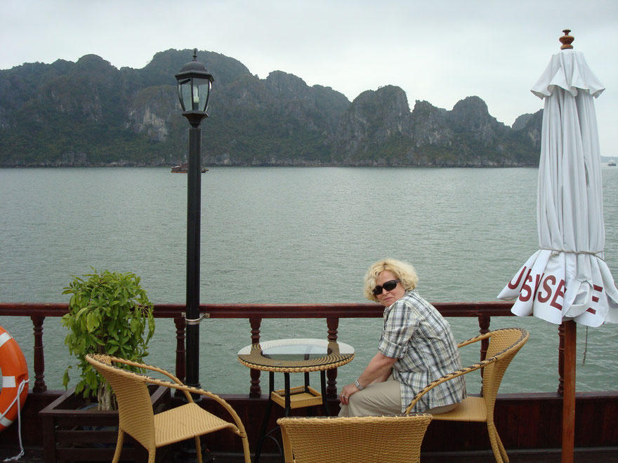 With boat at Halong Bay