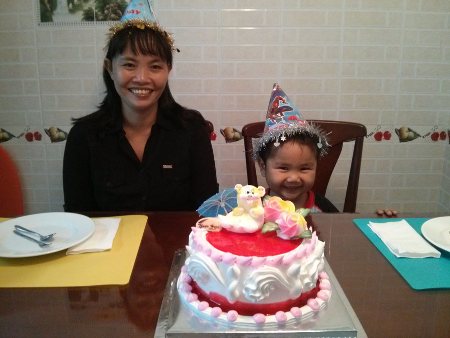 Luong and Dung with birthday cake
