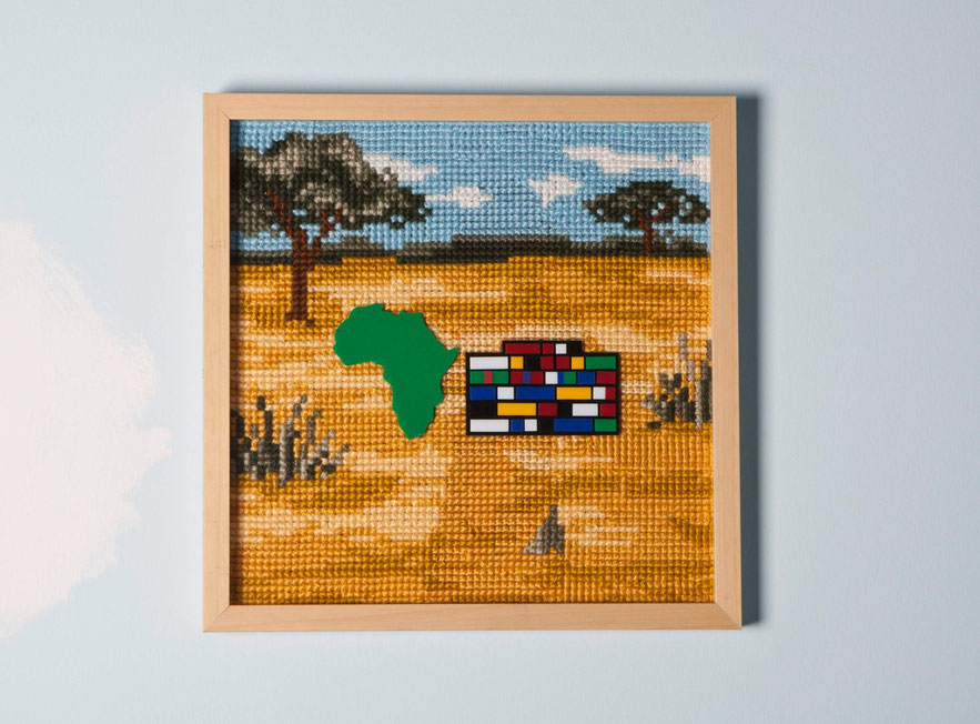 ''Kaddafi'' 2011,42,5 x 42,5 cm/cross stitch and plexiglass