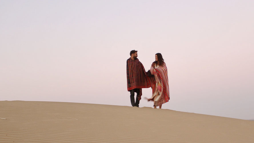 man and a woman on dune