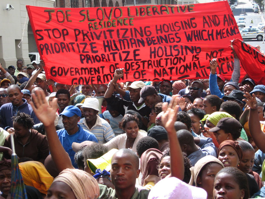 Residents of Joe Slovo informal settlement at Langa township protest outside Cape Town High Court in December 2007 against their forced eviction to a new township at Delft 34km north east of Cape Town