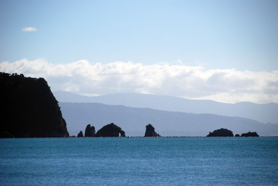 The rock formations off Abel Tasman Point and the ranges to the west.