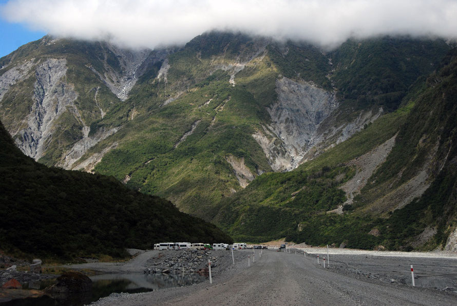 Looking up the lower Fox Glacier valley to the site of the once large terminal moraine subsequently eroded. The remnant forms the car park for the path to the glacier terminus.