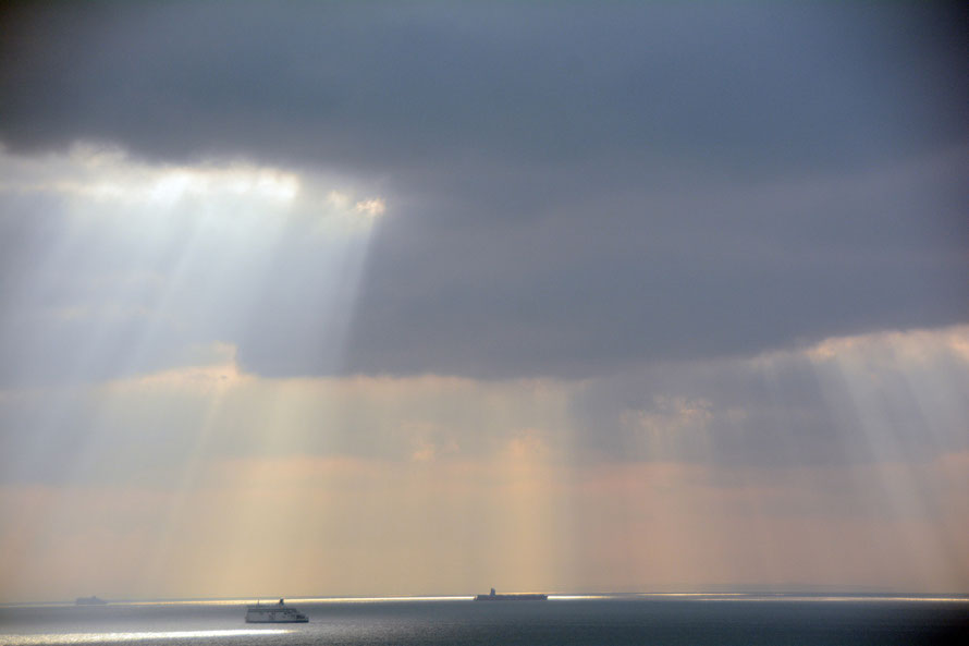The blip: 'Strait Lines' - another clever (ha ha) play on words - the Dover Strait and the horizon and sun ray lines and the shipping lines that use the Strait.