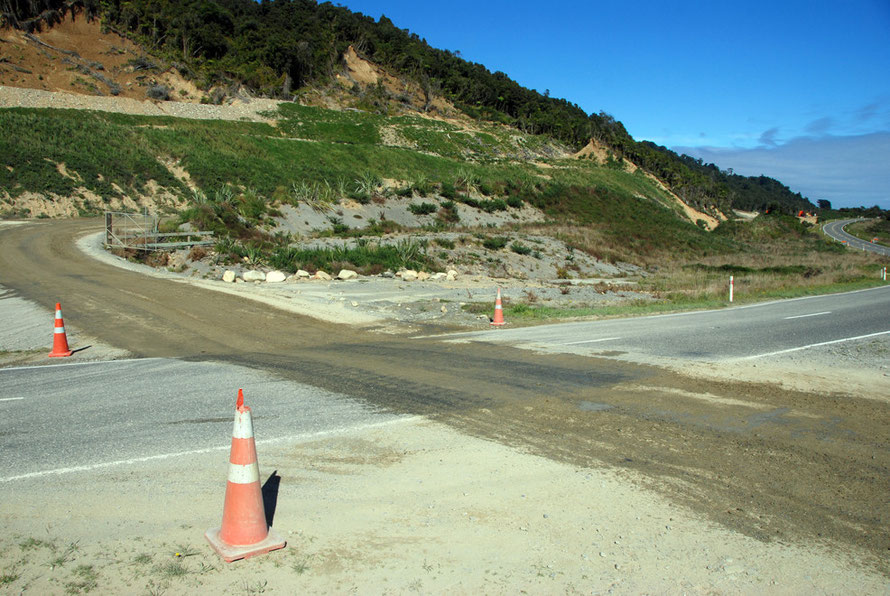 Who's right of way: mining truck tracks across State Highway 6 at Donoghues just south of Ross. Raised gold bearing beach sands and glacial moraines provide potentially rich pickings for West Coast go