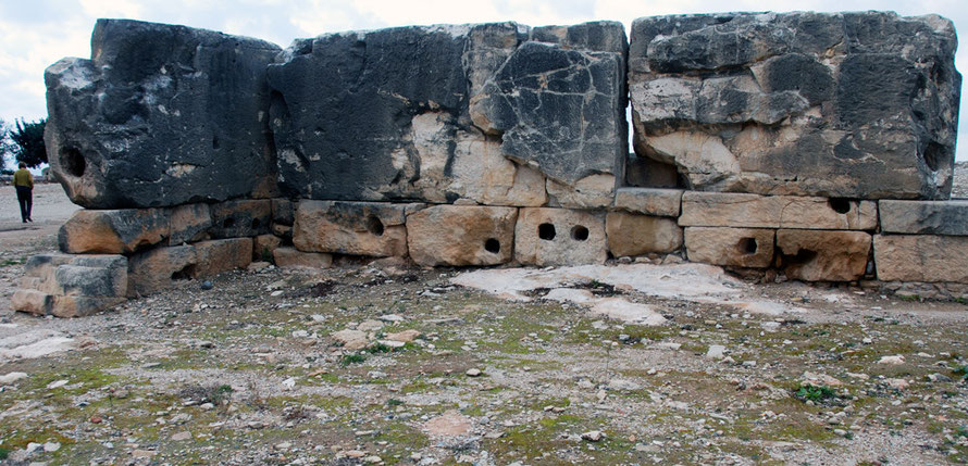 Huge blocks of stone (see figure for scale), with enigmatic square holes at Aphrodite's Sanctuary at Kouklia, January, 2013.