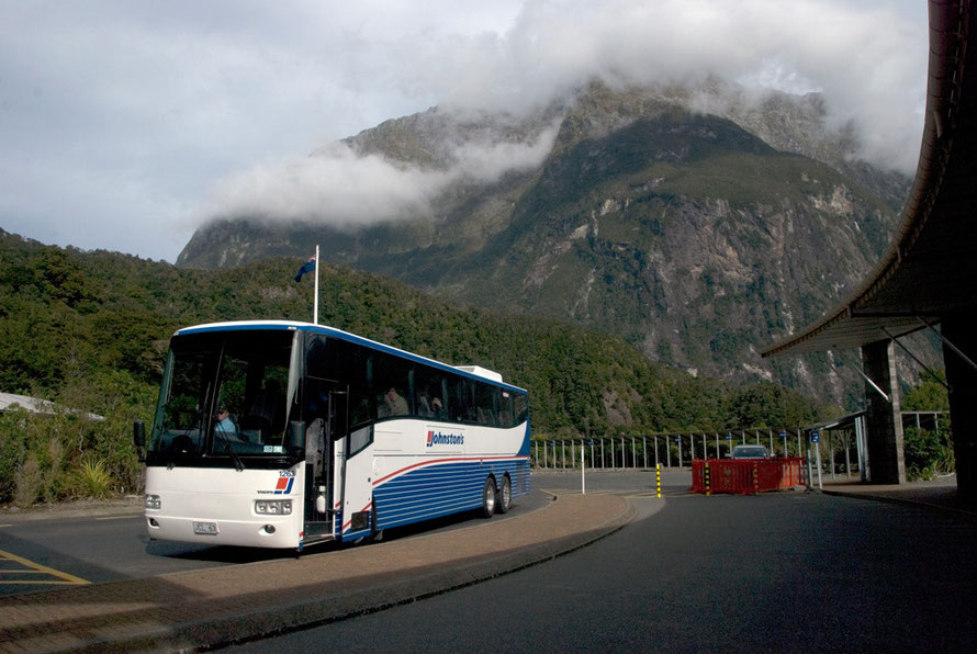 The Milford Sound coach terminus - the last evening visitors leaving. The fantastic bulk of Barren Peak (1561m) rearing up behind.
