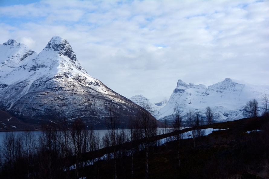 More of the fierce mountain landscape of the Lyngen Line in April 2015 looking towards Storfjord village and Kitdalen behind. Hatten peak on the lefdt at 1060m and the distant peak of Otertinden (1340m) on the right towering above Singnaldalen.