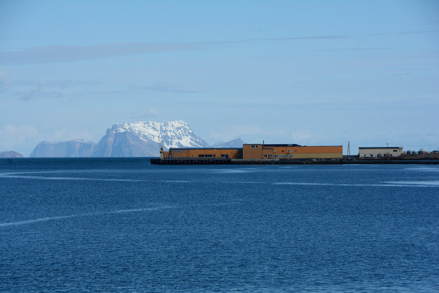 Sandneset fish plant on the Nord-Lenangen inlet of the Ullesfjord on the west side of the Lyngen Peninsula with Nord-Fulgøya Island in the background.