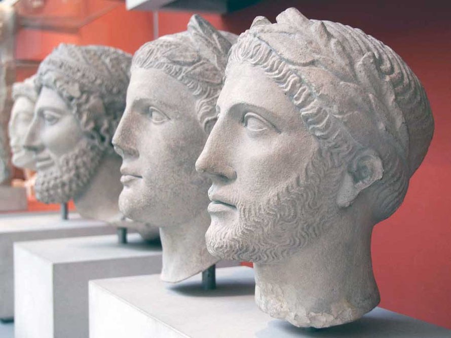 Three limestone heads from left to right 450BC head from Idalion,  300BC from Idalion and ??: British Museum