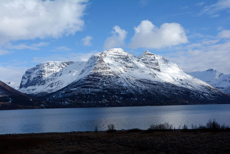 The Lyngen Line: looking east across the Storfjorden to the massive mountain blocks that rise very steeply from the fjord side to 1,200 to 1,500 metres (April 2015). Imagine this scene in the months of winter darkness when average temperatures are -6.5C.
