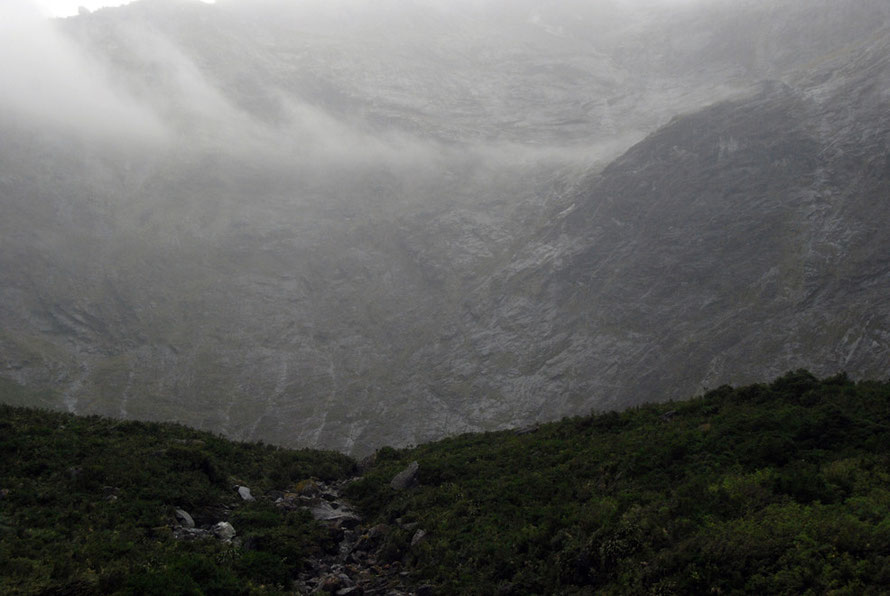 Mist and cloud hanging off the rock wall above the western portal of the Homer Tunnel on the Milford Road.