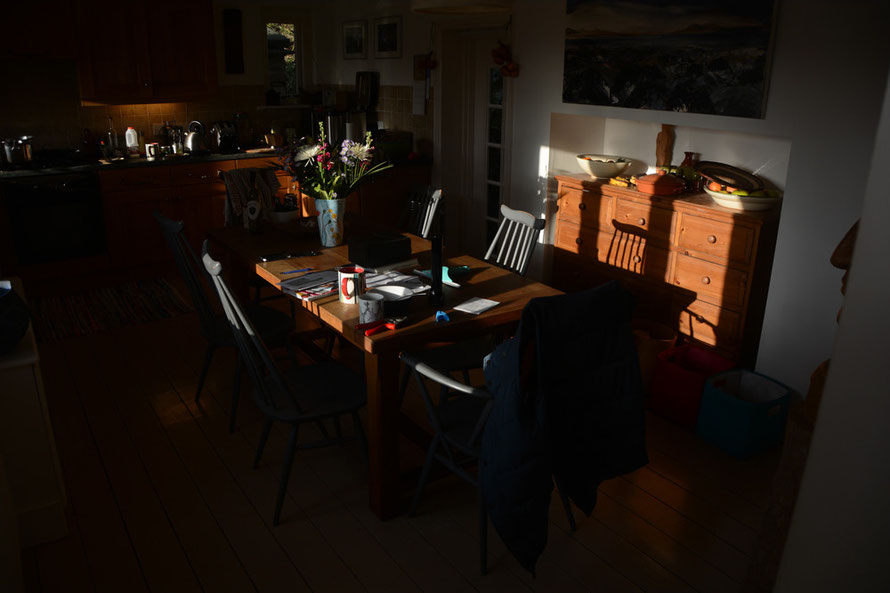The low sun lighting the kitchen.