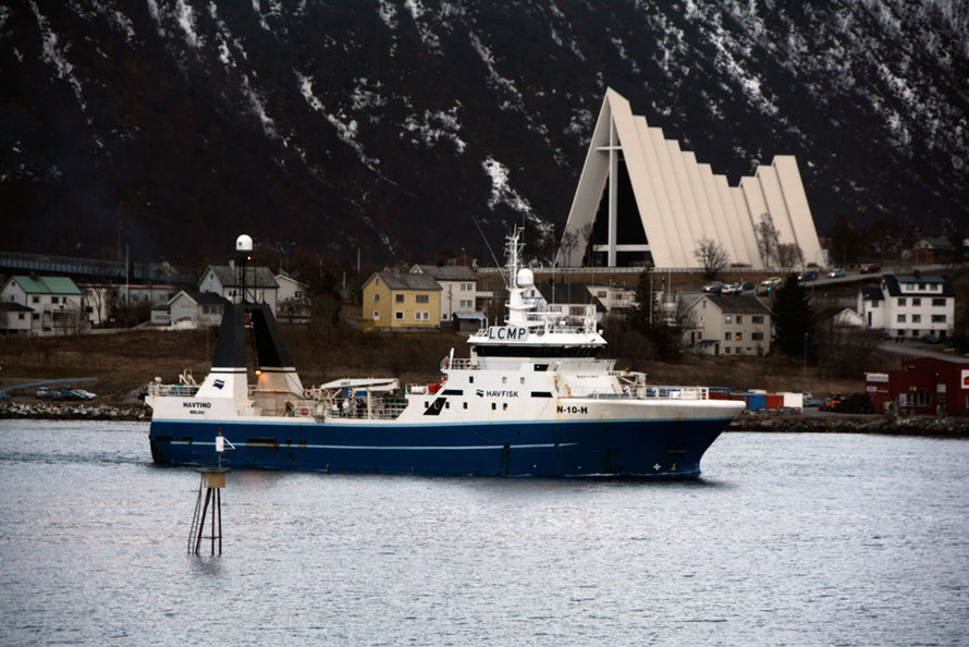Havtind, part of the Havfisk fleet, passing through Tromsø Harbour. Havfisk (formerly Aker Seafoods) operates a fleet of 15 whitefish trawlers and was caught up in the illegal dumping of cod from one of its trawlers in 2010.