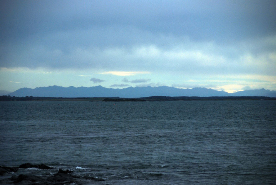 The mountains of Fiordland from Bluff Harbour looking north.