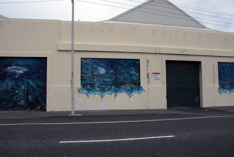 The old New Zealand Shipping Company Store No. 2 with murals, Bluff, Southland, NZ.