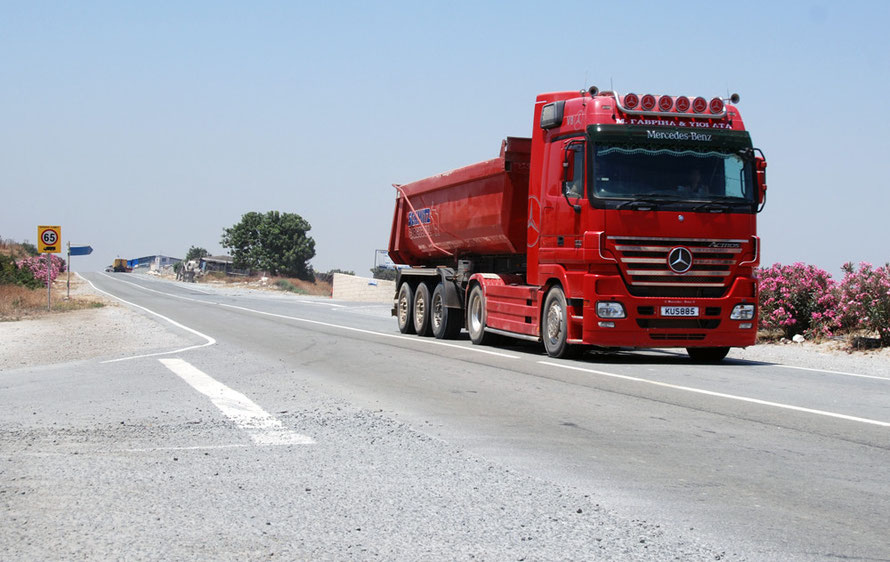 Truck rushing limestone to the cement works at Vasilikos.