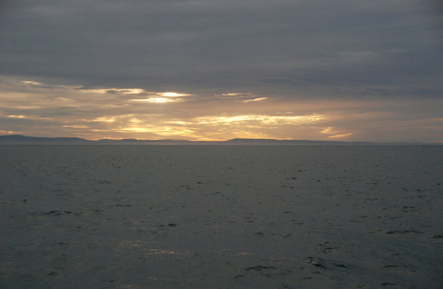 the mainland hills of the South Island from the Stewart Island Ferry.