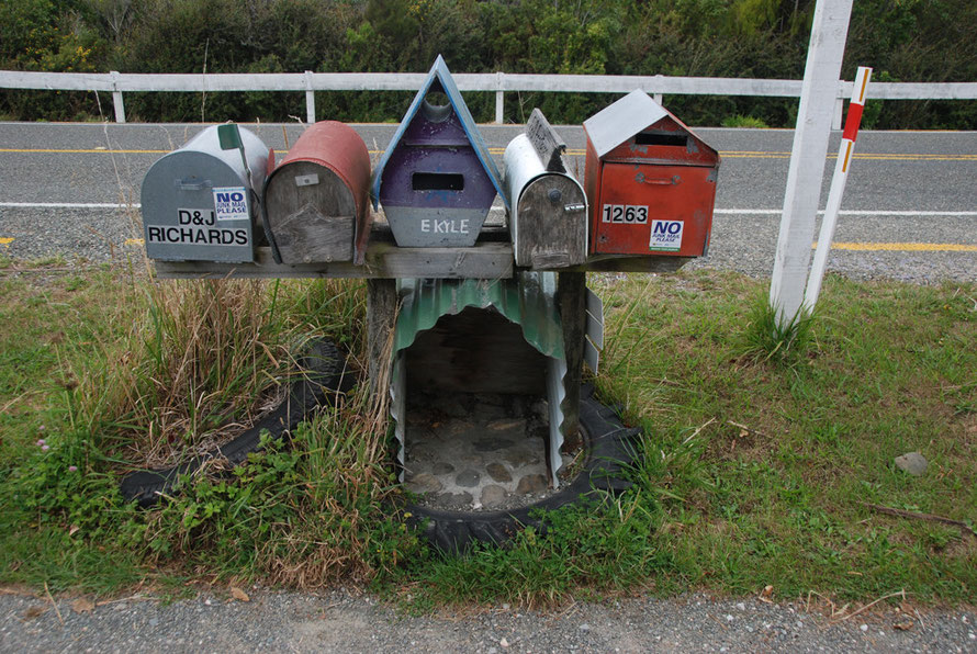 Post boxes near the Mussel Inn, Golden Bay.