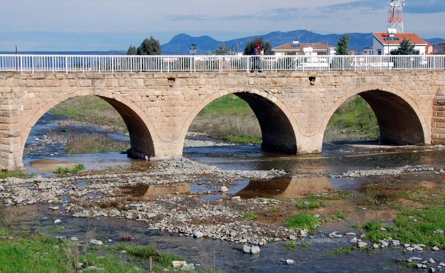Woman on the three-arched bridge at Peristerona