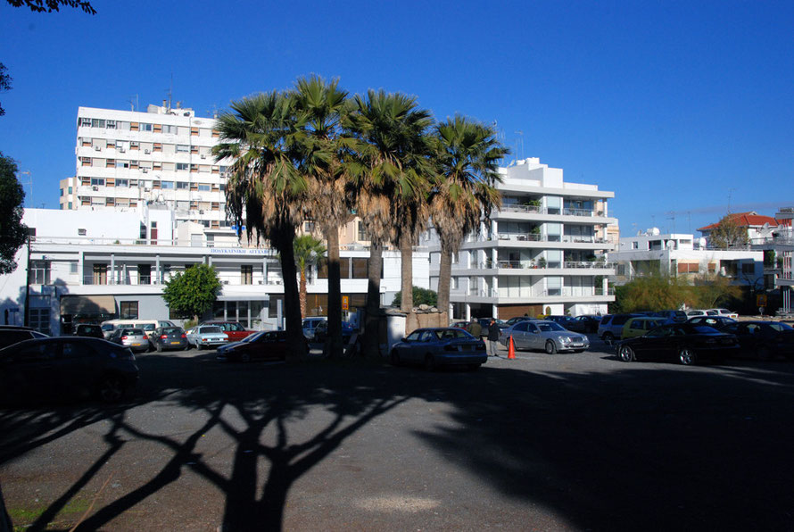 Older offices and flat with palm trees of Makarios Avenue, Nicosia.