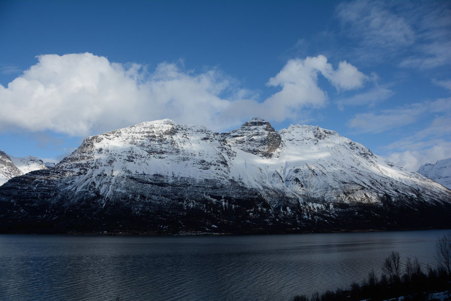 The Lyngen Line: looking east across the Storfjorden. The main route (Reichestrasse 50 - now the E8) built by slave labour north runs between the bottom of the mountain and the fjord side.
