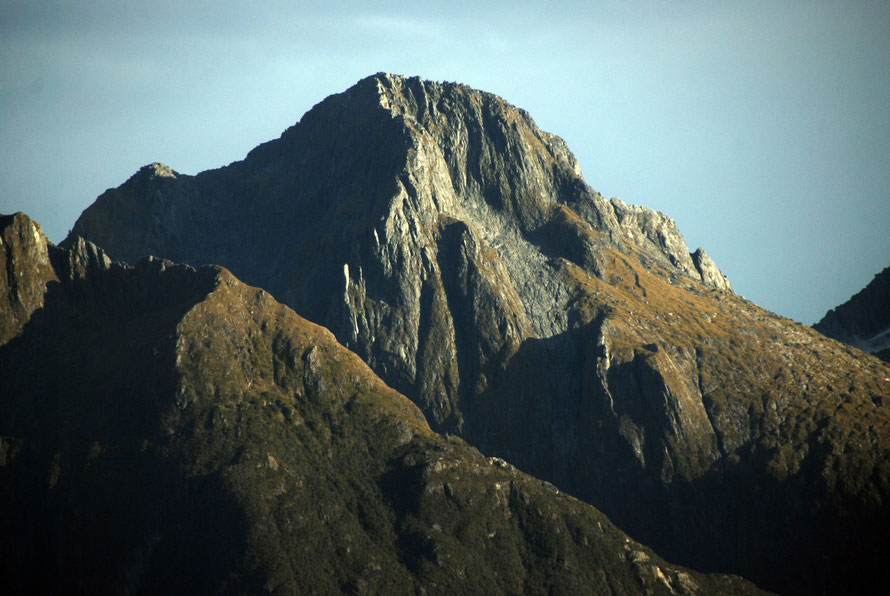 The glacially-eroded horn-like summit of Odyssey Peak to the south west of Milford Sound.