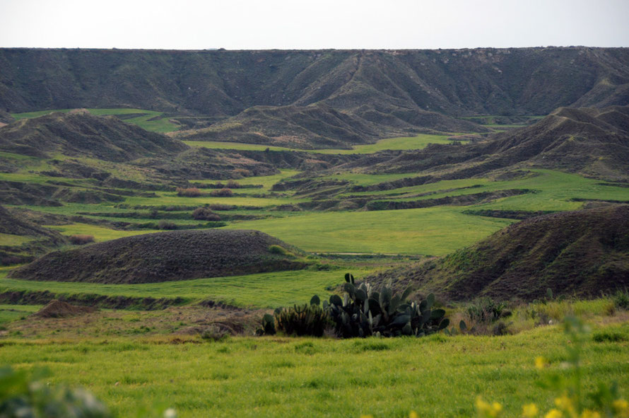 Flat topped land  eroded down into semi-terraced fields by milennia of cultivation near Tseri.