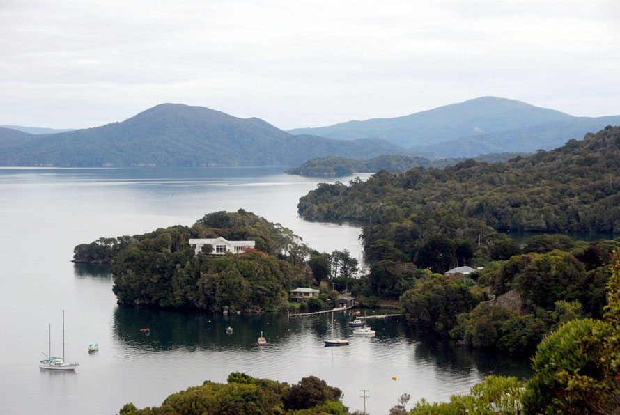View from the lookout above Oban over Golden Bay, Prices Inlet to (L) Mt Rakeahua (681m) and in the distance Mt Anglem/Hanahui (980m), Stewart Island.