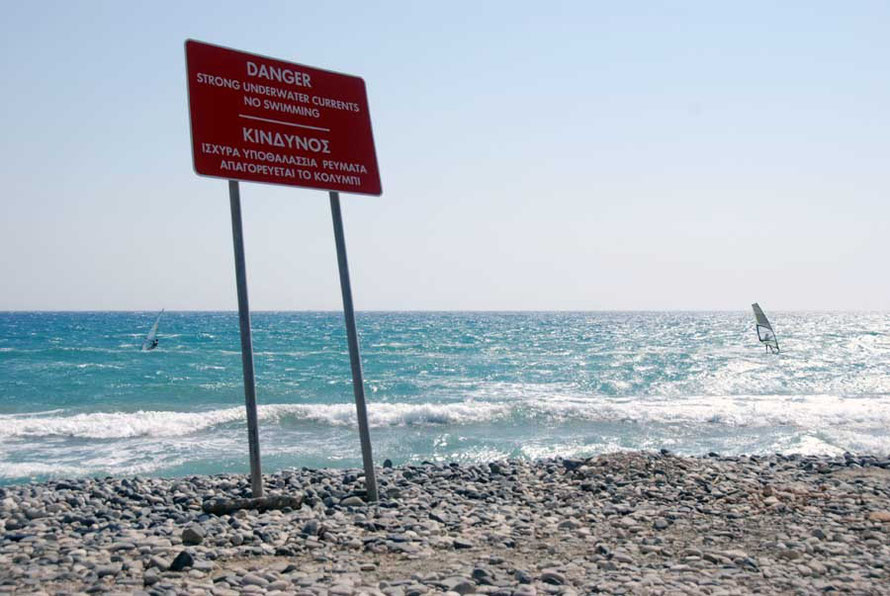 Dangerous waters for the economy: sign at Kourion Beach