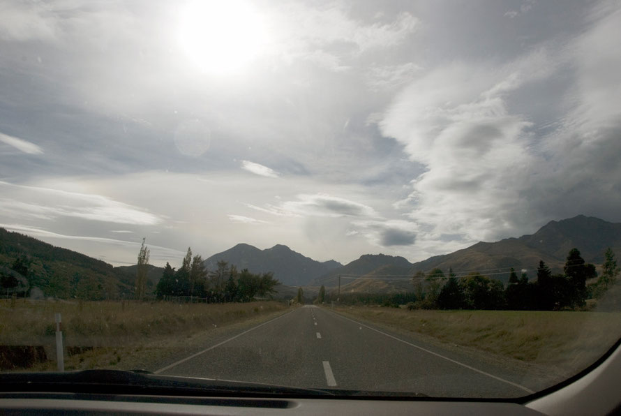 The empty straight road of the Southern Scenic Route south of Manapouri.Traffic was sparse and speeds were high.