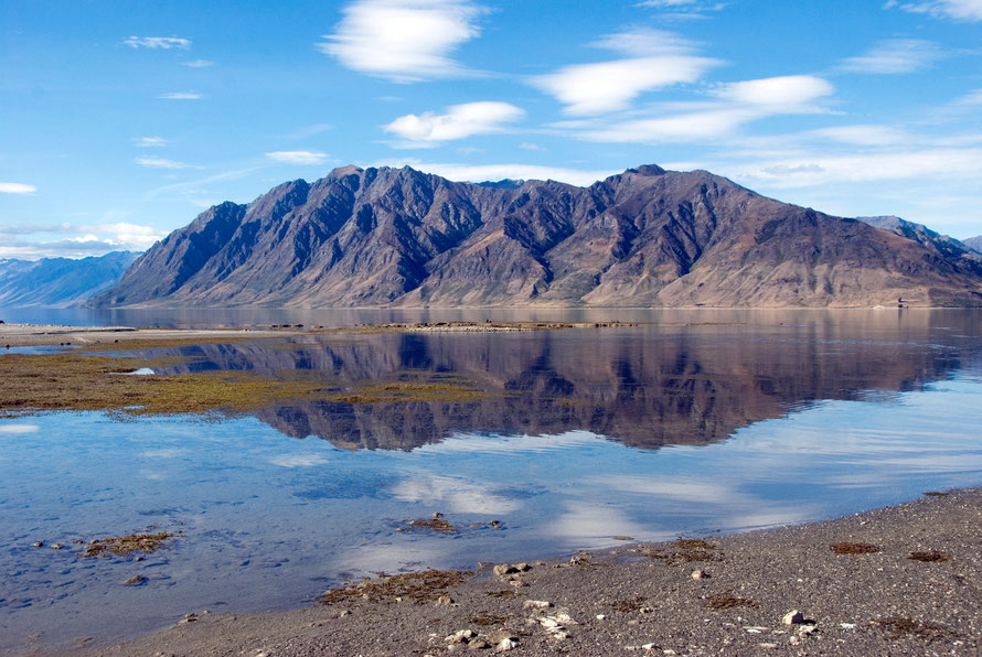 Lake Hawea in Central Otago. The lake is part of the Clutha/Mata-Au catchment and the level has been raised to control flow to the river hydro-electric schemes. This is it at low water in the summer.