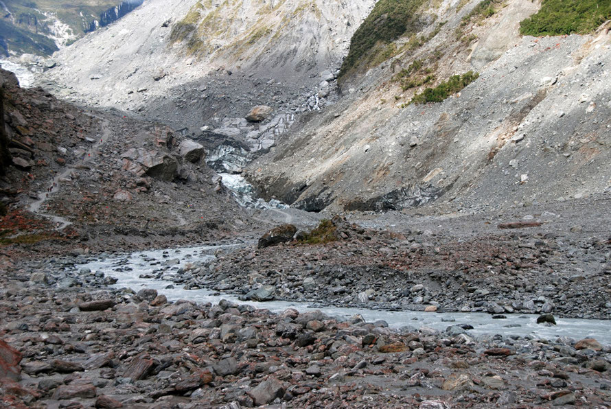 Glacial dust plays a vital role in releasing rock nutrients to plants and phytoplankton. This is the Fox Glacier's river outlet. Note the people on left for scale.