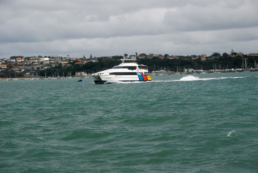 The Waiheke catamaran ferrry making speed along the South Shore of the Motokorea Channel as it heads into the Hauraki Gulf.