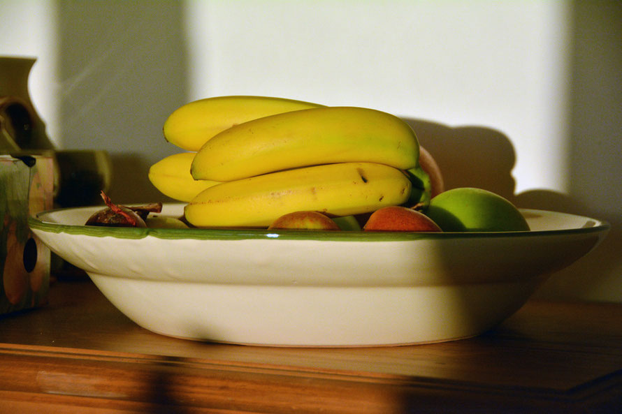 Low morning sunlight on the fruit bowl at 08.00.