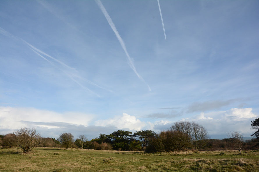 More con trails and big clouds over France and Belgium.