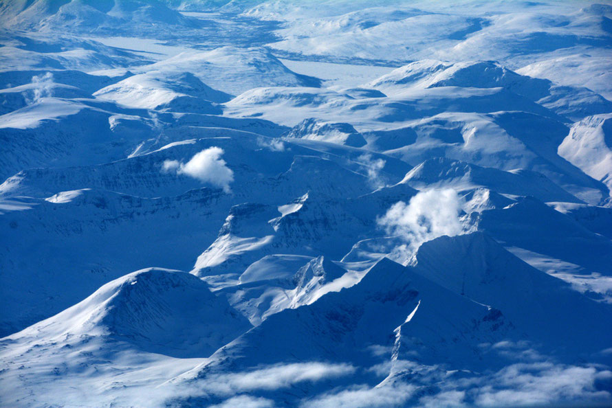 Mountains, mountains everywhere. Somewhere on the return flight from Tromso to Oslo.