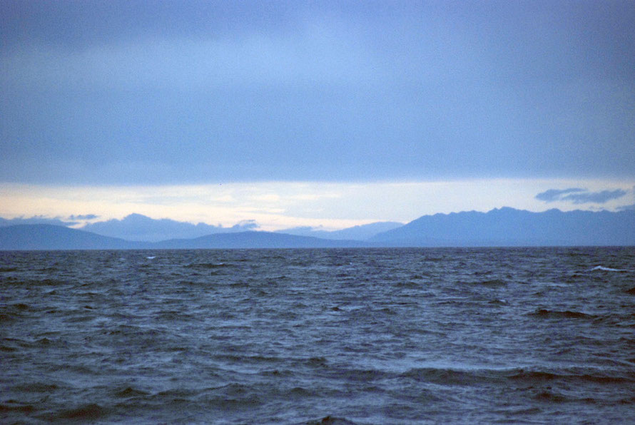 The mountains of Fiordland on the South Island from the Foveaux Strait.
