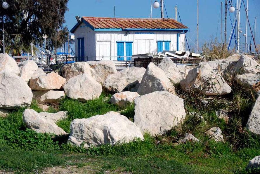 Blue and white hut with marina behind, Larnaca