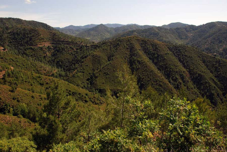Looking back from further away to Kampos, caught in the crook of the interlocking green hills of Marathasa