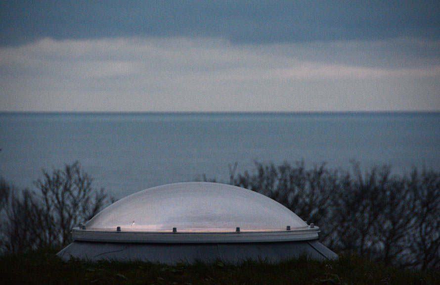 Blues and greys: the Strait, the sea, the clouds and the Calyx skylight lit from below, St Margarets Bay, Kent.