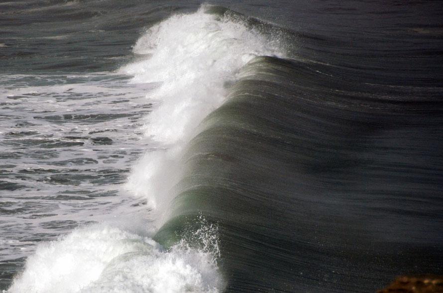 Big Tasman swell breaking around Dolomite Point, West Coast.