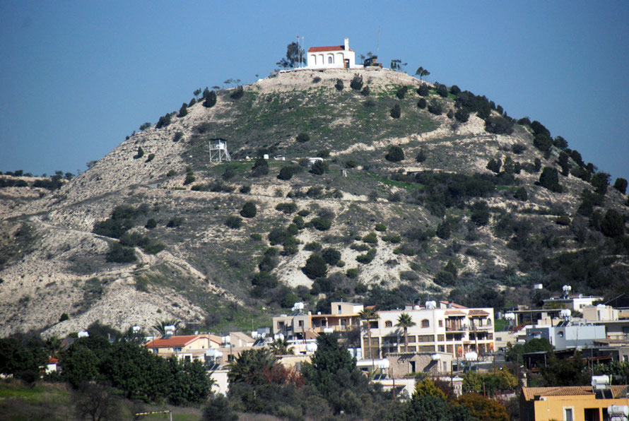 The Louroujina Salient and Green Line above houses on the road to Larnaca. The white raised platform halfway up the hill is a UNFICYPF post in the narrow buffer zone. The hilltop church is a Turkish military post.
